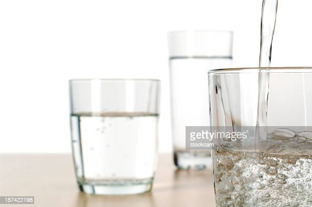 pouring glasses of water