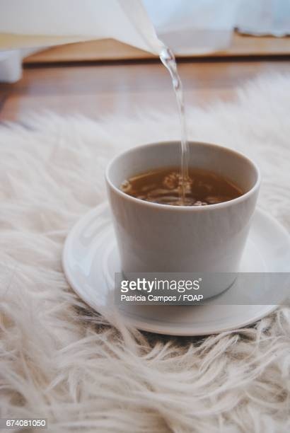 Pouring hot water in tea