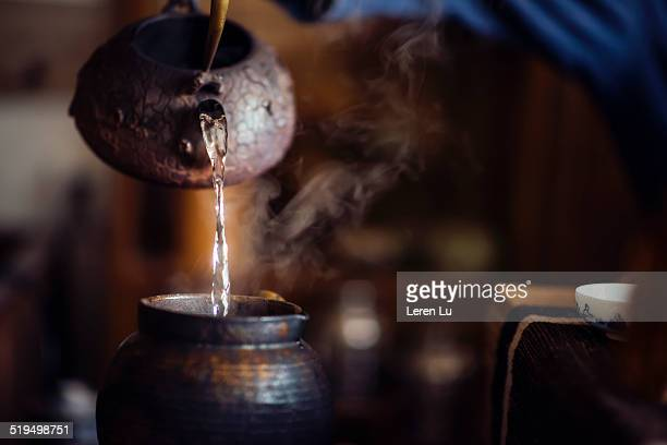Pouring hot water into a copper jar
