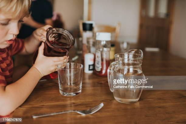 pouring juice - juice drink stock pictures, royalty-free photos & images