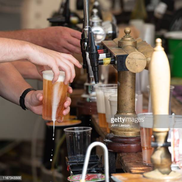 pouring lager - edinburgh stock pictures, royalty-free photos & images