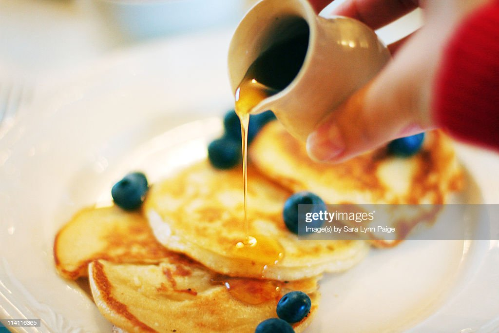 Pouring Maple Syrup Over Pancakes : Stock Photo