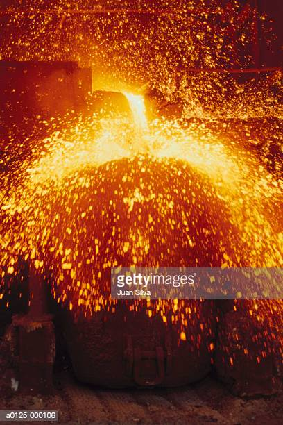 pouring molten steel - steelmaking stock photos and pictures