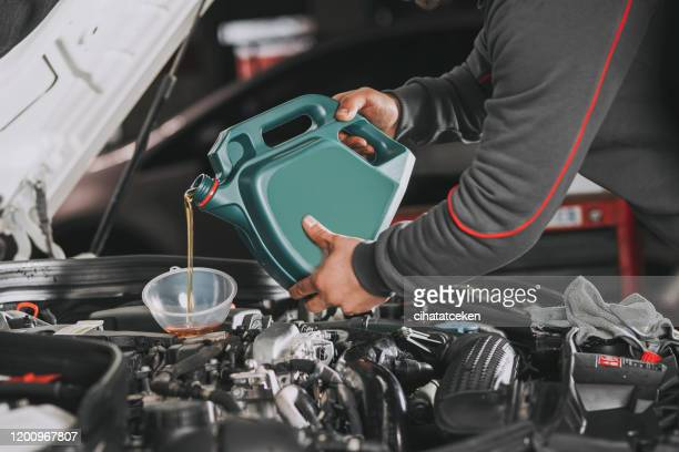 pouring oil to car engine. - motor oil stock pictures, royalty-free photos & images