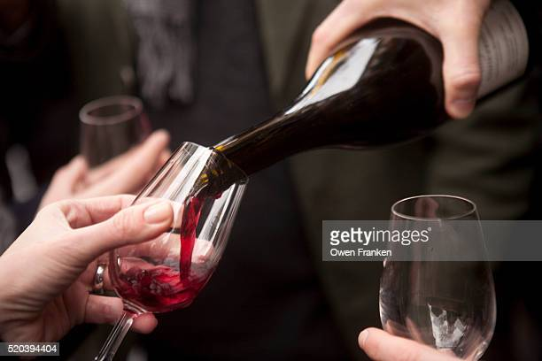 Pouring red wine at a Beaujolais nouveau festival