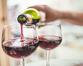 Pouring red wine in glasses