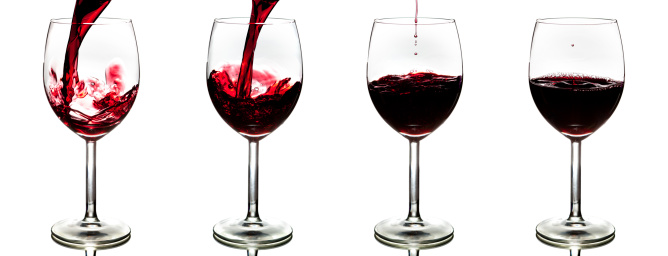 pouring red wine isolated 475152549
