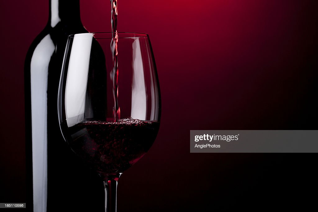 Pouring red wine : Stock Photo
