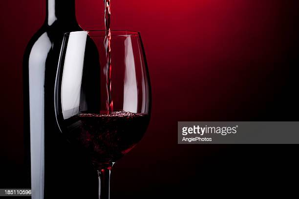 pouring red wine - wine glass stock pictures, royalty-free photos & images