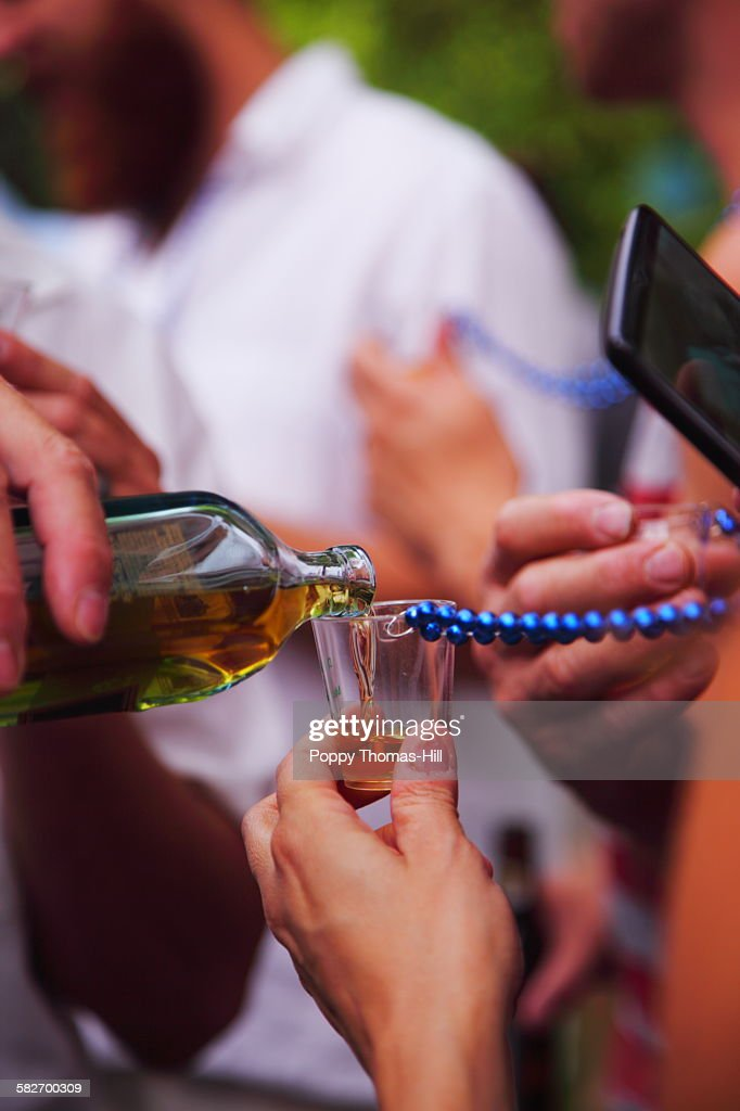 Pouring Scotch Whiskey into shot glass : Stock Photo
