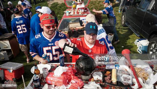 Pouring shots of traditional Polish cherry vodka into a bowling ball while tailgating at the Hammer's Lot at the Pinto Ron tailgate party before the...