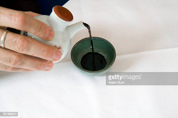 pouring soy sauce - soy sauce stock pictures, royalty-free photos & images