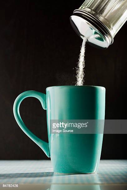 pouring sugar into a coffee cup - sugar coffee stock photos and pictures