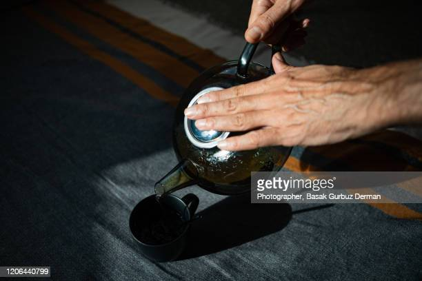 pouring tea into cup - steeping stock pictures, royalty-free photos & images