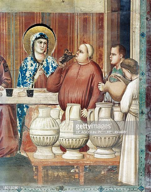 Pouring the wine detail from The Marriage Feast at Cana Life of Christ 13041306 fresco by Giotto Scrovegni Chapel Padua Veneto Italy