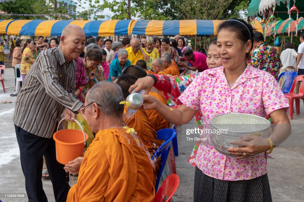 Pouring water on monks for Songkran festival. : Stock Photo