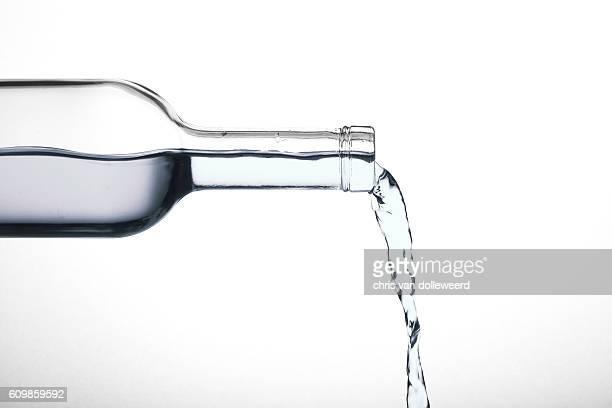 pouring water - füllen stock-fotos und bilder