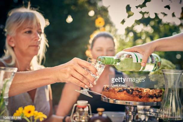 Pouring white at dinner party in garden