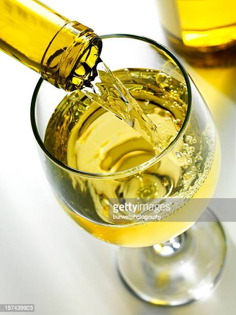 pouring white wine - chardonnay grape stock photos and pictures
