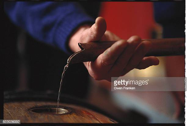 Pouring Wine into a Cask
