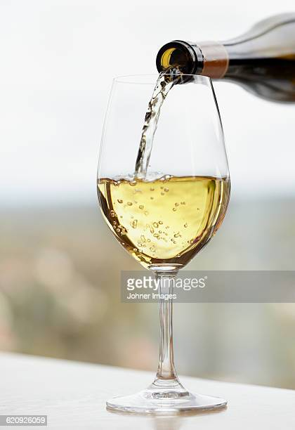 pouring wine into glass - white wine stock pictures, royalty-free photos & images