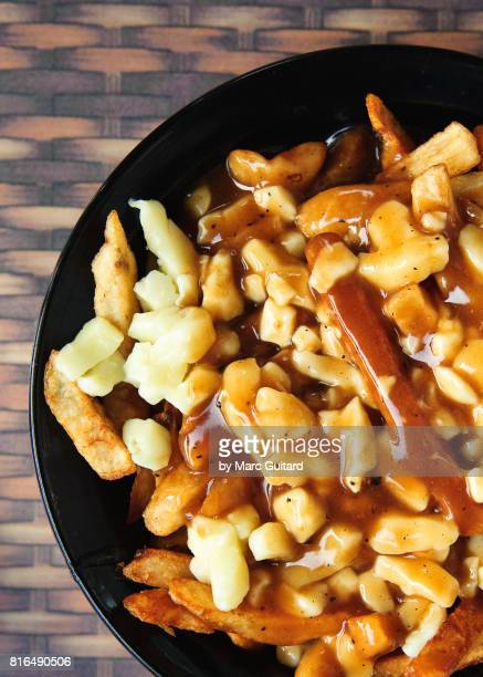 poutine at a pub in mont tremblant, quebec, canada - mont tremblant stock pictures, royalty-free photos & images