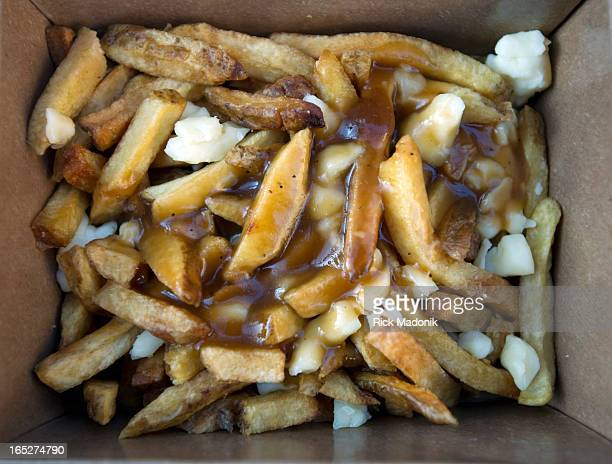 09/24/11 TORONTO ONTARIO Poutine dripping in gravy ready to be consumed Two contests for competitive eating one for amateurs and one for...