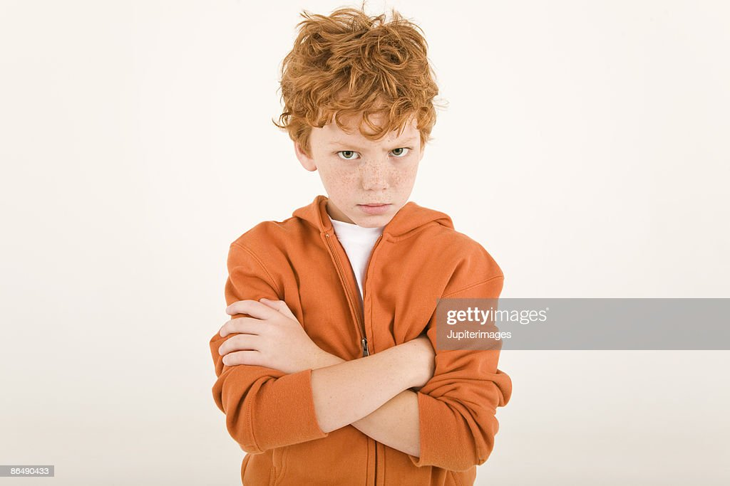 Pouting boy with arms crossed : Stock Photo