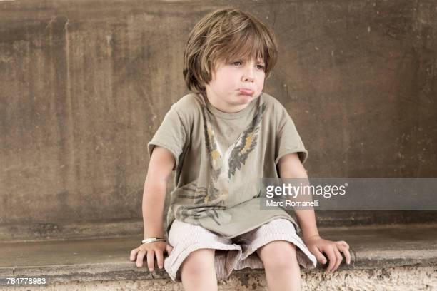 Pouting Caucasian boy