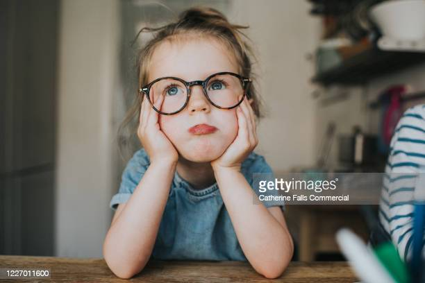 pouting child in glasses - solutions stock pictures, royalty-free photos & images