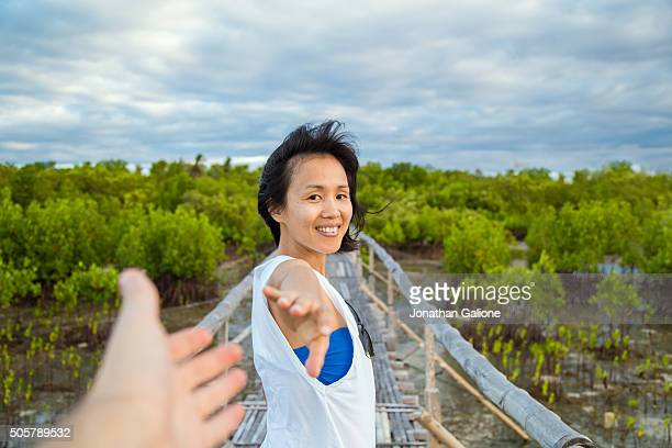 PoV of a woman stood on a bridge looking back over her shoulder