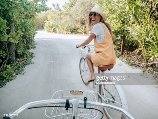 pov point of view of couple cycling on tropical island - tourist resort stock pictures, royalty-free photos & images