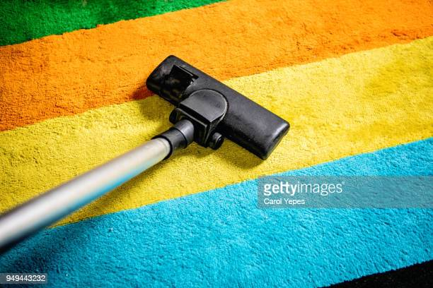 pov vacuum cleaner on carpet - janitorial services stock photos and pictures