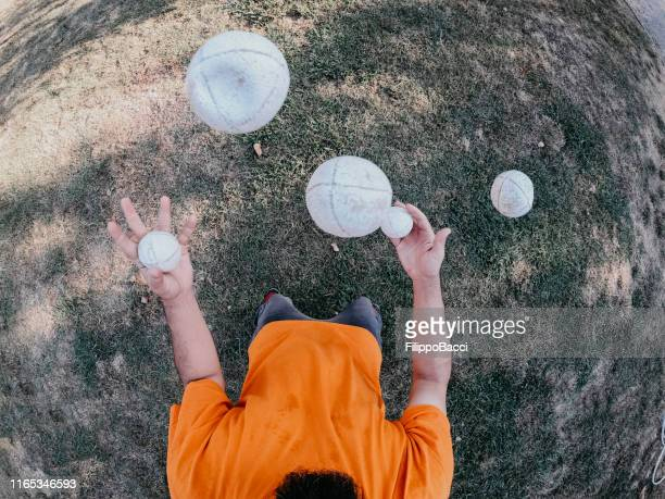 pov view of a juggler performing at the park - juggling stock pictures, royalty-free photos & images