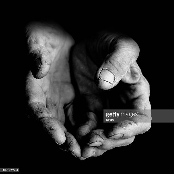 poverty - black and white hands stock pictures, royalty-free photos & images