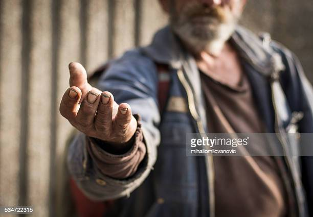 poverty - human arm stockfoto's en -beelden