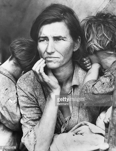 A povertystricken migrant mother with three young children gazes off into the distance This photograph commissioned by the FSA came to symbolize the...