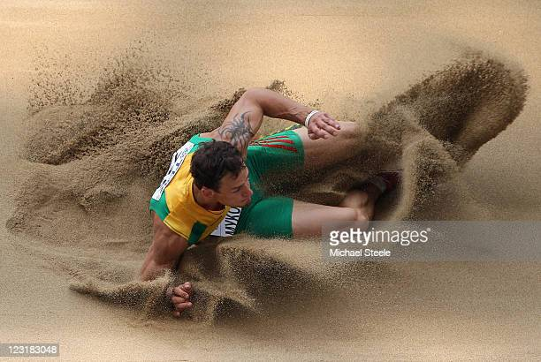 Povilas Mykolaitis of Lithuania competes in the men's long jump qualification round behind two judges during day six of the 13th IAAF World Athletics...