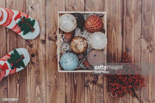 pov.Xmas socks and ornaments on wooden surface