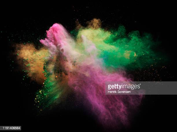 powder explosion - slow motion stock pictures, royalty-free photos & images