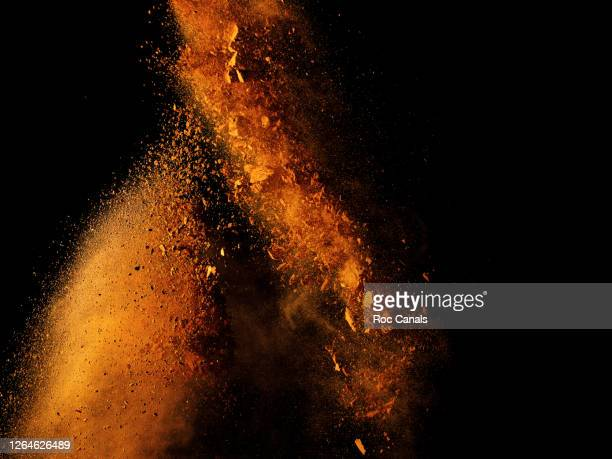powder explosion - sand stock pictures, royalty-free photos & images