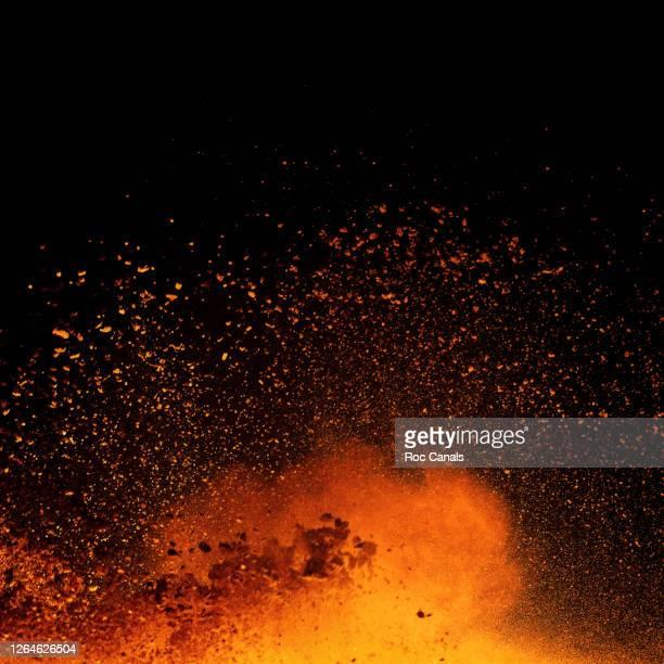powder explosion - orange burst stock pictures, royalty-free photos & images