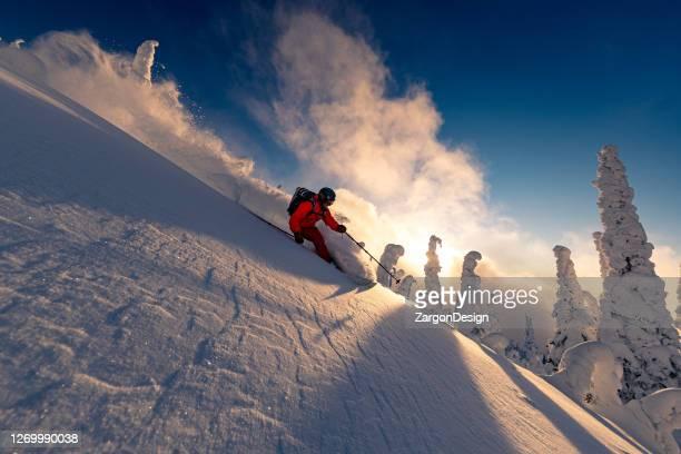 powder skiing at resort - okanagan valley stock pictures, royalty-free photos & images