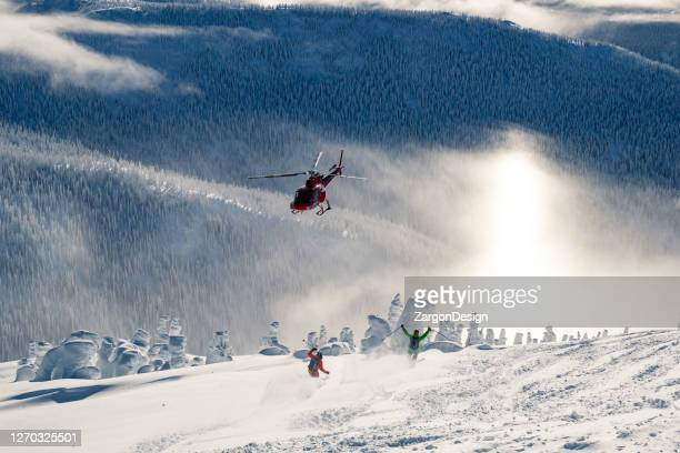 powder skiing - helicopter stock pictures, royalty-free photos & images