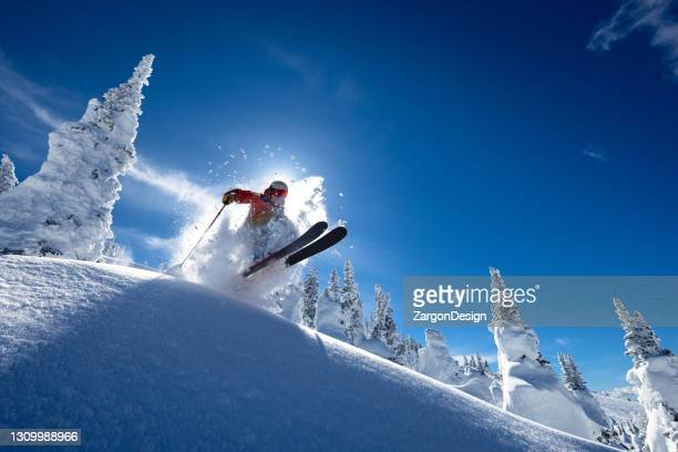 powder skiing - skiing stock pictures, royalty-free photos & images