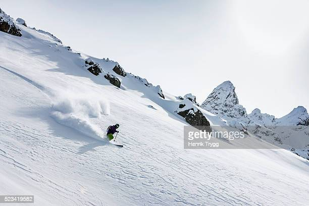 powder skiing - swiss alps stock pictures, royalty-free photos & images