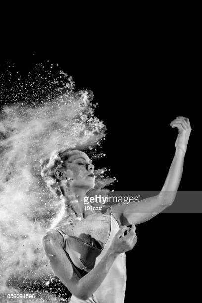powder splashing beautiful woman face
