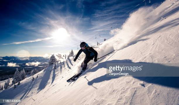 powder turns - downhill skiing stock pictures, royalty-free photos & images