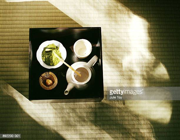 powdered green tea, tea pot and cup set up on tray for tea ceremony - ceremony stock pictures, royalty-free photos & images
