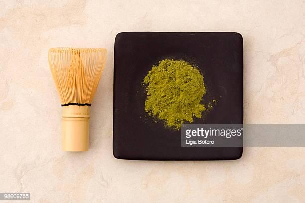 Powdered matcha tea and whisk